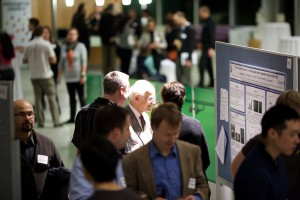 Dr. Charles Tator reviews research posters at ICORD's Annual Research Meeting in February 2012