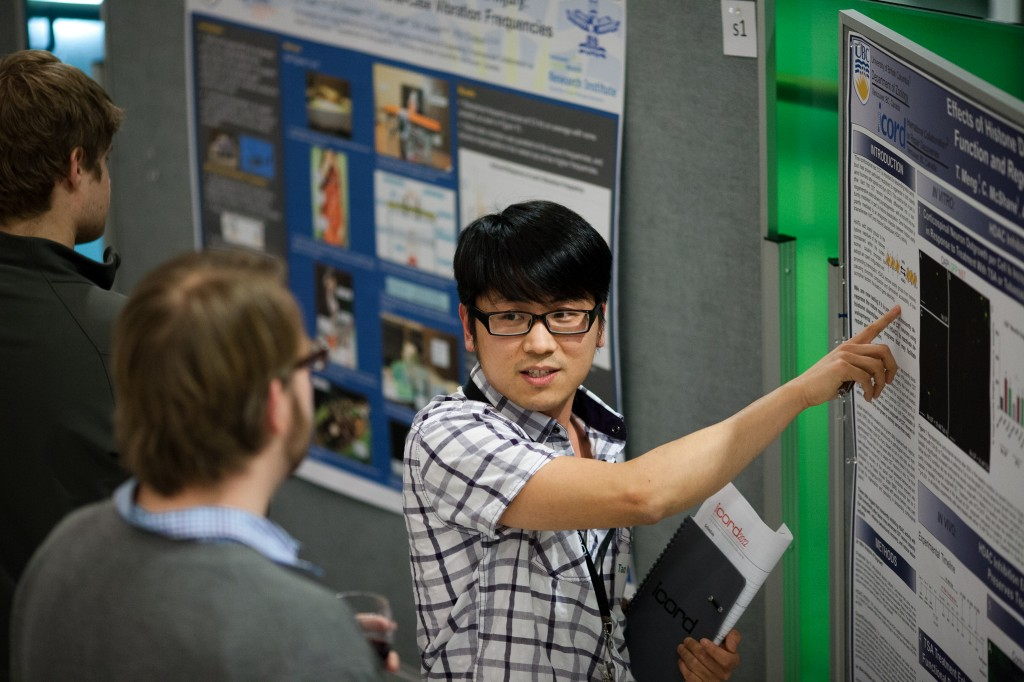 Graduate student presents his research poster at ICORD's Annual Research Meeting in February 2012