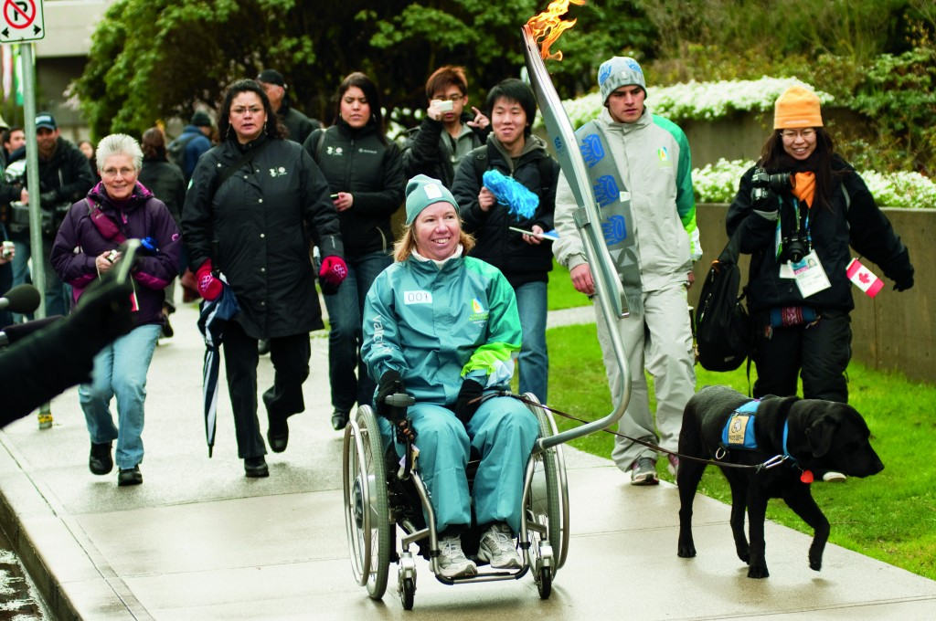 Dr. Bonnie Sawatzky carries the 2010 Paralympic Torch at UBC in February, 2010