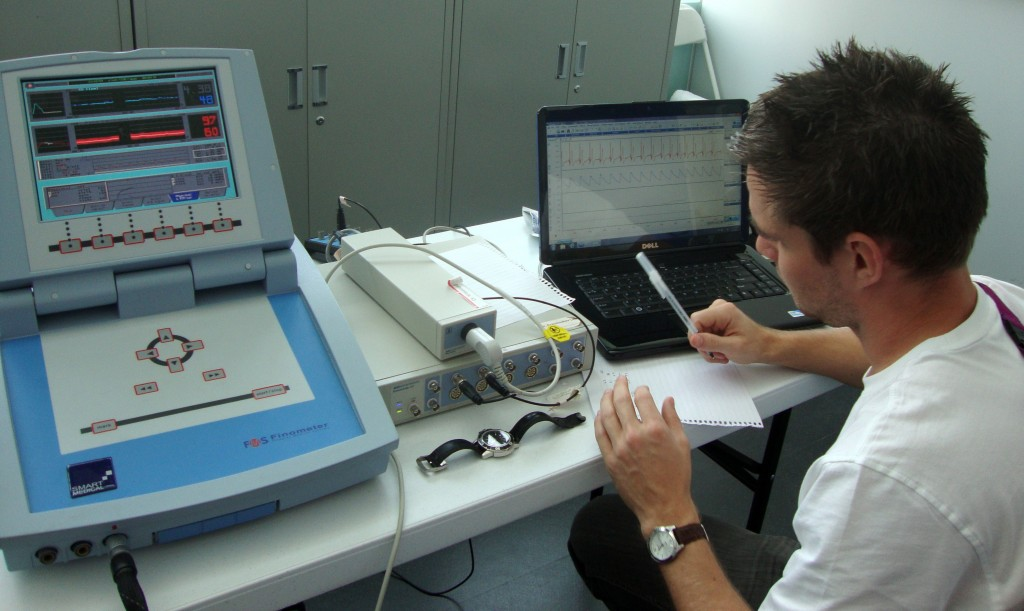 Dr. West working at the London2012 Paralympic cardiovascular clinic
