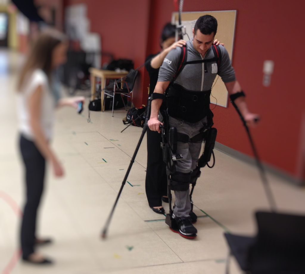 Research participant Kyle Gieni is learning to use the Ekso suit.