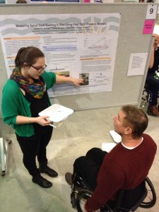 Trainee Jackie Soicher explains her research to Rick Hansen