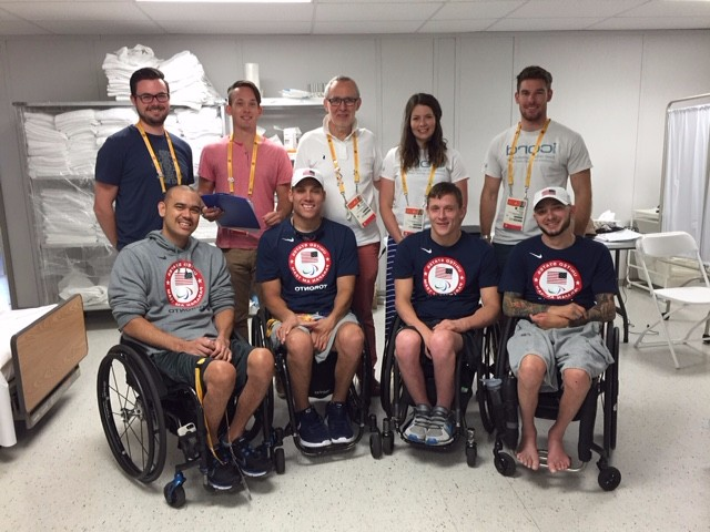 "The Krassioukov lab meets members of the USA Wheelchair Rugby team. ""We met amazing people, developed friendships, and hopefully made a difference,"" says Dr. Phillips. ""The camaraderie was incredible."" This was the Krassioukov Lab's sixth clinic done in collaboration with the International Paralympics Committee."