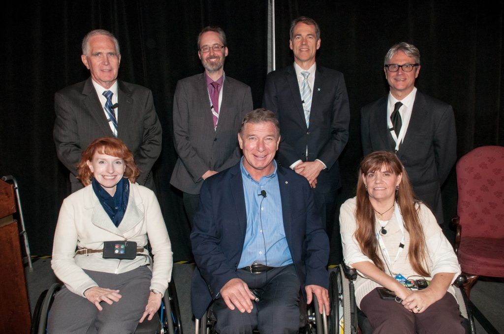Praxis 2016 Opening Session Speakers. Back row, L-R: Graham Creasey (Stanford School of Medicine), Eric Marcotte (CIHR), Bill Barrable (Rick Hansen Institute), Francesco Marincola (Sidra Medical and Research Centre). Front row, L-R: Jennifer French (Neurotech Network), Rick Hansen (Rick Hansen Foundation), and Kim Anderson-Erisman (Miami Project to Cure Paralysis).