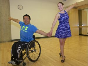 Wheelchair dancer Vince Preap and dance partner Cadi Fortes. June 24 2016, Photo by Francis Georgian, Reporter Jenny Lee, Location UBC. [PNG Merlin Archive]